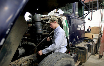 Sarah Nader - snader@shawmedia.com Lance DeRosa, 18, of Johnsburg fixes up an old truck in his heavy equipment/diesel mechanics class at Johnsburg High School on Thursday, January 24, 2013. The school is expanding their vocational programs next year. Some classes will be expanded to full semesters and more level classes will be added to others.