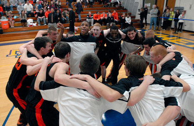 The Wheaton Warrenville South Varsity Boys Basketball team huddles up prior to tip-off of a game at Wheaton North on Friday, Jan. 18, 2013. Matthew Piechalak— mpiechalak@shawmedia.com.