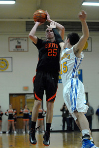 Wheaton Warrenville South senior guard Michael Kramer shoots a jump shot with a defender's hand in his face during a game at Wheaton North on Friday, Jan. 18, 2013. Matthew Piechalak— mpiechalak@shawmedia.com.