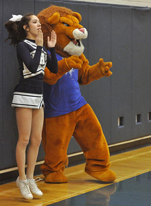Sophomore Victoria Shane gets some unsolicited cheerleading help from the Lisle Lion. Lisle plays Walther Lutheran in varsity boys basketball on Monday, Jan. 28, 2013 in Lisle. Bill Ackerman — backerman@shawmedia.com