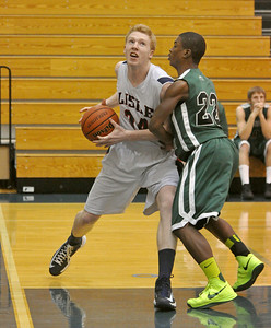 Lisle's Shane Murray drives hard on the baseline with Walther Lutheran's Najee Toomer on his shoulder on Monday, Jan. 28, 2013 in Lisle. Bill Ackerman — backerman@shawmedia.com