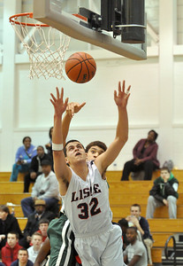 Lisle's Jeremy Glavanovits puts up a shot against Walther Lutheran on Monday, Jan. 28, 2013 in Lisle. Bill Ackerman — backerman@shawmedia.com