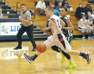 Lisle's Cody Monson motors down court so fast his feet barely touch the floor against Walther Lutheran in Lisle on Monday, Jan. 28, 2013. Bill Ackerman — backerman@shawmedia.com