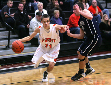 Monica Maschak - mmaschak@shawmedia.com McHenry's Nick Bellich keeps his defender at a distance as he makes his way to the hoop in the first half of the game against Cary-Grove on Wednesday, January 16, 2013. The McHenry Warriors won 63-58.