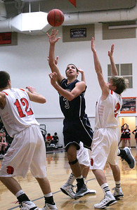 Monica Maschak - mmaschak@shawmedia.com Cary-Grove's Tyler Szydlo aims for the hoop in a game against McHenry  on Wednesday, January 16, 2013. McHenry won 63-58.