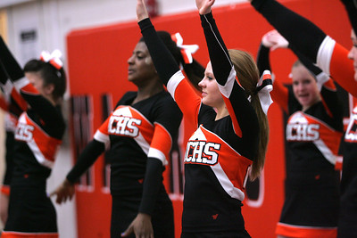 Monica Maschak - mmaschak@shawmedia.com McHenry High School cheerleaders cheer on the boys basketball team after scoring a point against Cary-Grove on Wednesday, January 16, 2013.