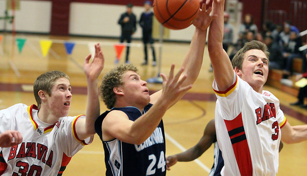 Batavia's Jake Pollack, right, and Tucker Knox battle for a rebound with Centennial's Austin Turley during Saturday's game at the 38th annual Elgin Holiday Basketball Tournament.<br /> Elgin 12/29/12(Jeff Krage photo for the Kane County Chronicle)
