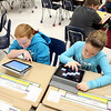 Alice Gustafson Elementary School fifth graders Molly Schuster and Gabbie Watson use their iPads for a project Wednesday.(Sandy Bressner photo)