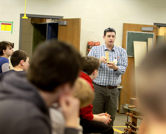 Tony Malay, president of the Batavia Education Association, teaches a shop class to seventh graders at Rotolo Middle School in Batavia Wednesday morning.(Sandy Bressner photo)