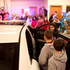 Sixth graders at Kaneland Harter Middle School in Sugar Grove check one of three new squad cars purchased by the Sugar Grove Police Department.(Sandy Bressner photo)