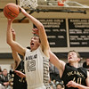 Kaneland's Matt Limbrunner (42) tries to get a shot off during the third quarter in Maple Park, Ill., Tuesday, Jan. 22, 2013. Kaneland defeated Sycamore, 43-42. (Rob Winner photo)