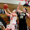St. Charles East's Amanda Hilton goes up for a shot under Streamwood's Hannah McGlone during their game Tuesday night at East. (Sandy Bressner photo)