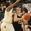 Kaneland's Brooke Harner (22) is fouled while shooting by Sycamore's Taiya Hopkins (left) late during the fourth quarter in Sycamore, Ill., Friday, Jan. 18, 2013. Sycamore defeated Kaneland in overtime, 49-48. (Rob Winner photo)