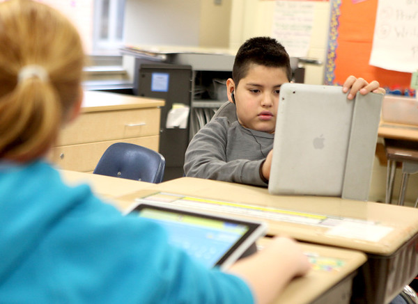 Alice Gustafson Elementary School fifth grader Jordan Ramirez uses an iPad for a project Wednesday.(Sandy Bressner photo)