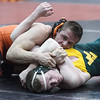 St. Charles East's Jordan Meadows (right) attempts to position Waubonsie Valley's Jack Timberlake for a pin during their 182 pound 3rd place match at the UEC WRESTLING MEET at Batavia HighSchool in Batavia, IL on Saturday, January 19, 2013 (Sean King for The Kane County Chronicle)