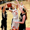 St. Charles East's Kyra Washington has her shot blocked by Streamwood's defense during their game Tuesday night at East. (Sandy Bressner photo)