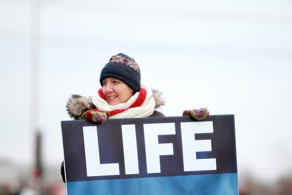 Missy Bergquist of the Christian Liberty Academy holds a sign outside the Planned Parenthood in Aurora Saturday morning. Today is the 40th anniversary of Roe vs. Wade, the historic U.S. Supreme Court decision that determined access to abortion.(Sandy Bressner photo)