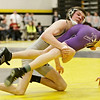 Kanland's Connor Williams (left) lifts Rochelle's Jacob Seldal in a 120-pound match during the Northern Illinois Big 12 Conference Tournament in Sycamore, Ill., Saturday, Jan. 19, 2013. (Rob Winner photo)
