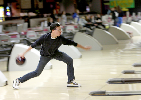 St. Charles East senior Alex Garza bowls with his teammates Tuesday at Bowling Green Lanes in West Chicago. Garza will be competing in this weekend's IHSA State Tournament.(Sandy Bressner photo)