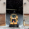 Geneva Public Works employee Steve Smith uses a front loader to gather salt at the public works facility Wednesday afternoon. (Sandy Bressner photo)