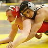 Kaneland's Esai Ponce (top) controls LaSalle-Peru's Jake Nolan in a 132-pound match during the Northern Illinois Big 12 Conference Tournament in Sycamore, Ill., Saturday, Jan. 19, 2013. Ponce won with a pin over Nolan. (Rob Winner photo)
