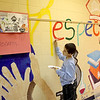 Fifth grader Noah Uher paints part of a mural on the wall at the Mades-Johnstone Center in St. Charles. (Sandy Bressner photo)