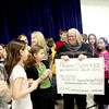 Jane Benedic (center)t, facility coordinator for the Kane County chapter of the American Red Cross, accepts a check for $1,000.90 from students at Anderson Elementary School in St. Charles. The students raised the money to go toward Hurricane Sandy relief.(Sandy Bressner photo)