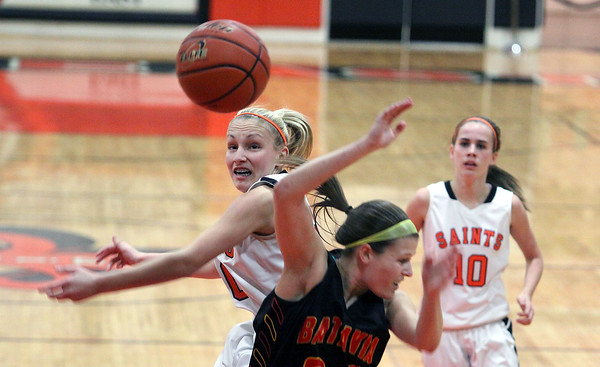 St. Charles East's Katie Claussner swats the basketball out of the hands of Batavia's Jenny Welday during Saturday's game in St. Charles.<br /> (Jeff Krage photo for the Kane County Chronicle)
