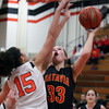 Batavia's Erin Bayram is fouled by St. Charles East's Kyra Washington during Saturday's game in St. Charles.<br /> (Jeff Krage photo for the Kane County Chronicle)