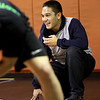 St. Charles East wrestler Keone Derain jokes around during practice Monday afternoon. (Sandy Bressner photo)