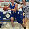 Geneva's Sami Pawlak pushes past Kyla Helsel of St. Charles North during the St. Charles North vs. Geneva High School on Saturday, Jan. 5 in St. Charles.