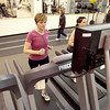 Amy Snyder, an employee of Cadence Health, runs on the treadmill at the Delnor Health and Wellness Center in Geneva Thursday afternoon. Snyder takes advantage of the discount membership provided by Cadence. (Sandy Bressner photo)