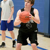 St. Charles North junior Erik Miller shoots the ball during practice at the school Wednesday afternoon.(Sandy Bressner photo)