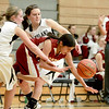Kaneland's Sarah Grams (2) and Allyson O'Herron battle a Morris player for the ball during their game in Maple Park Tuesday.(Sandy Bressner photo)