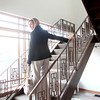 Cheryl Denz heads up the stairs of her new Riverview Counseling Services facility in downtown St. Charles. (Sandy Bressner photo)