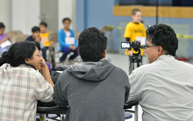 Sunny Balantrapu (from left), Aditya Gautam, and Vijay Balantrapu watch and record third graders competing in the West Chicago Elementary School District 33 spelling bee semi-final at West Chicago Middle School on Tuesday, Jan. 22, 2013. Rithvik and Roshni Balantrapu finished first and second, respecitvely. Bill Ackerman — backerman@shawmedia.com