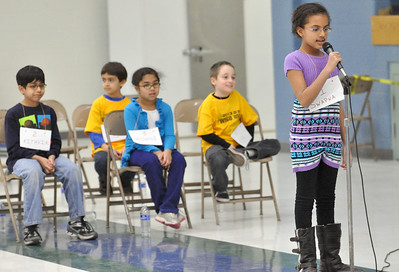 Third graders Rithvik Balantrapu (from left), Diego Mackintos (back row), Roshni Balantrapu, and Asa Kuharich, wait for their turn as Swapna George spells her word as they compete in the West Chicago Elementary School District 33 spelling bee semi-final at West Chicago Middle School on Tuesday, Jan. 22, 2013. Bill Ackerman — backerman@shawmedia.com
