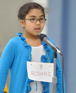 Third grader Roshni Balantrapu spells another word correctly as she competes in the West Chicago Elementary School District 33 spelling bee semi-final at West Chicago Middle School on Tuesday, Jan. 22, 2013. Bill Ackerman — backerman@shawmedia.com