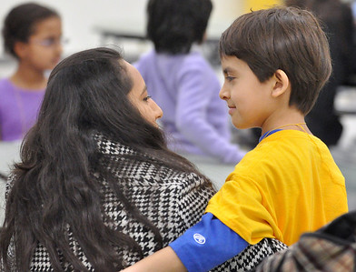 Diego Mackintos, 8, gets a hug from his mom, Veronica, after he is eliminated for the spelling bee semi-final championship. Third graders compete in the West Chicago Elementary School District 33 spelling bee at West Chicago Middle School on Tuesday, Jan. 22, 2013. Diego is one of five students who will go on to compete in the spelling bee final. Bill Ackerman — backerman@shawmedia.com
