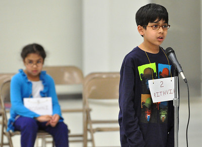 Roshni Balantrapu (left) sits to see if she will get a second chance to compete for first place with Rithvik Balantrapu, as he spells his word correctly winning first place. Third graders compete in the West Chicago Elementary School District 33 spelling bee semi-final at West Chicago Middle School on Tuesday, Jan. 22, 2013. Bill Ackerman — backerman@shawmedia.com