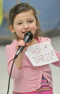 Mia Strezo, 3, grabs the mic after the West Chicago Elementary School District 33 spelling bee semi-final is over. Her brother, Dario, was one of the third graders competing at West Chicago Middle School on Tuesday, Jan. 22, 2013. Mia will have to wait a few more years. Bill Ackerman — backerman@shawmedia.com