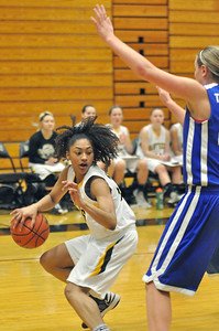Glenbard North's Kailey James drives to the key in the Panthers' home game with Wheaton North on Thursday, Jan. 10, 2013. Bill Ackerman — backerman@shawmedia.com