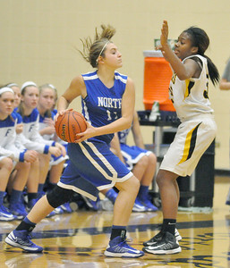 Wheaton North's Cassidy Graham looks for a passing outlet, guarded by Glenbard North's Laila Pickens, in Carol Stream on Thursday, Jan. 10, 2013. Bill Ackerman — backerman@shawmedia.com