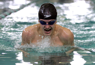 Monica Maschak - mmaschak@shawmedia.com Henry Gantner, for the Woodstock Dolphins, breathes during his 100 yard breaststroke race at the Woodstock North Boys Swim invitational on Saturday, January 19, 2013.  Gantner placed third with a time of 1:05.06.  The Woodstock Dolphins placed first.
