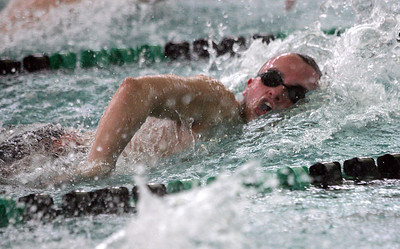 Monica Maschak - mmaschak@shawmedia.com Adam Jensen, for McHenry, speeds down the lane to win first place in the senior 100 yard freestyle race during the Woodstock North Boys Swim invitational on Saturday, January 19, 2013.  The Woodstock Dolphins placed first overall.