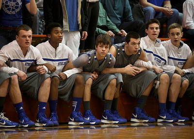 Josh Peckler - Jpeckler@shawmedia.com Members of the Woodstock bench link arms as Woodstock prepared to make a last second shot during the fourth quarter at Crystal Lake Central High School Friday, January 11, 2013.