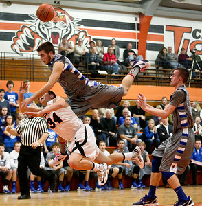 Josh Peckler - Jpeckler@shawmedia.com Woodstock's Andy Buhrow flies over the back of Crystal Lake Central's Jake Vanscoyoc as he attempts a layup during the second quarter at Crystal Lake Central High School Friday, January 11, 2013.