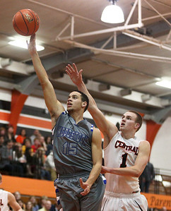 Josh Peckler - Jpeckler@shawmedia.com Woodstock's Keeondae Benjamin puts up a shot in front of Crystal Lake Central's Corban Murphy during the third quarter at Crystal Lake Central High School Friday, January 11, 2013.