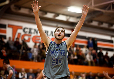 Josh Peckler - Jpeckler@shawmedia.com Woodstock's Andy Buhrow puts his arms up in the air after he was called for a foul during the first quarter at Crystal Lake Central High School Friday, January 11, 2013.
