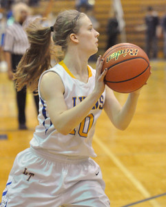 """Lyons Township's Victoria Swift takes an inbound pass in the Lions game with York. LT holds a """"Pack the Place"""" event with back to back girls and boys basketball games, with fundraising by LT school organizations on Saturday, Jan. 26, 2013. Bill Ackerman — backerman@shawmedia.com"""